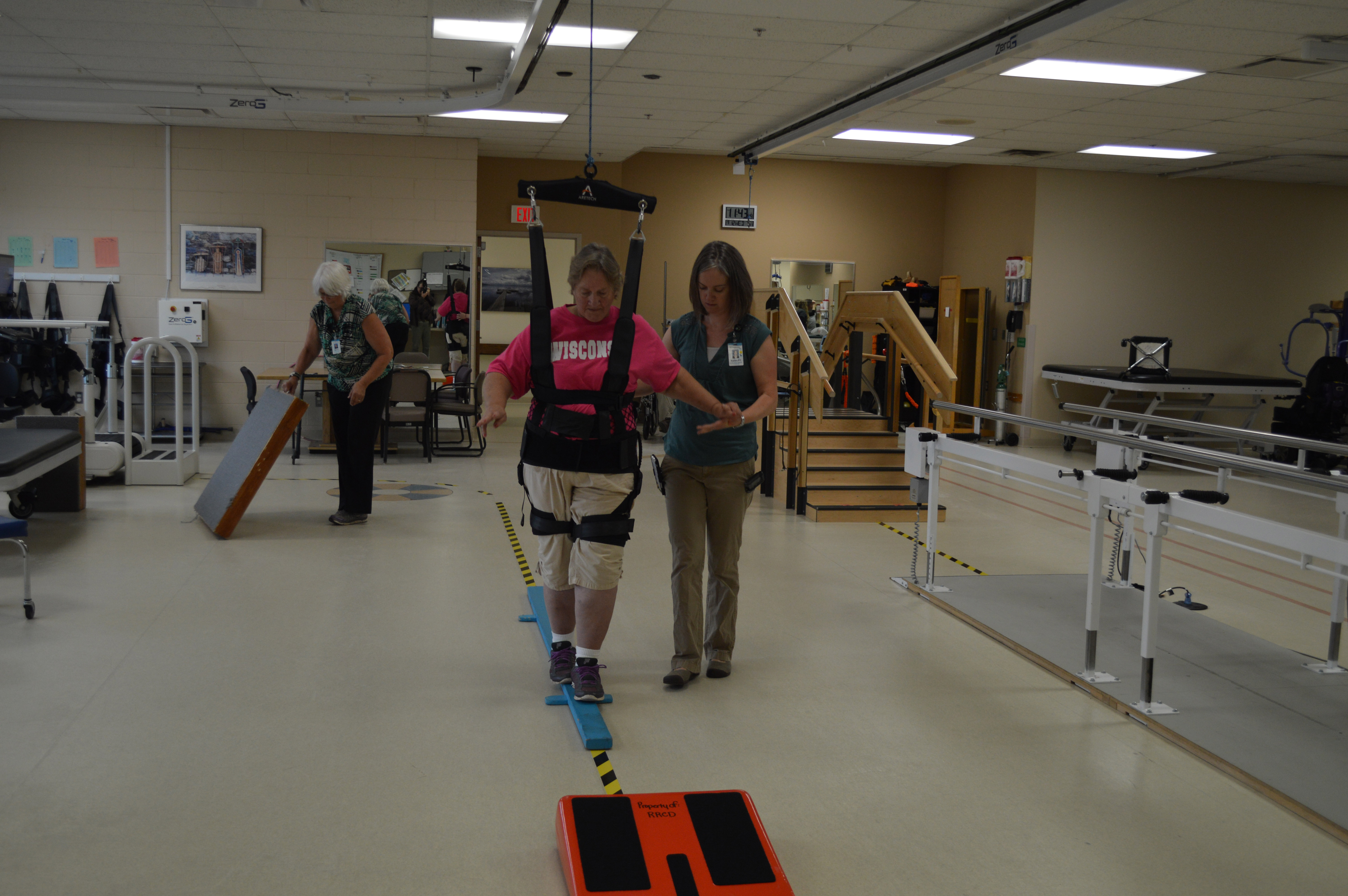 Physical therapy rehab assisted walking on equipment