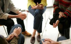 Group of people sitting in a support circle