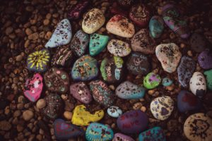 Arrangement of multi-colored painted rocks